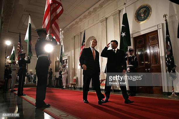 President George W Bush walks with Pakistan President General Pervez Musharraf thru the Cross Hall towards the East Room at the White House for a...