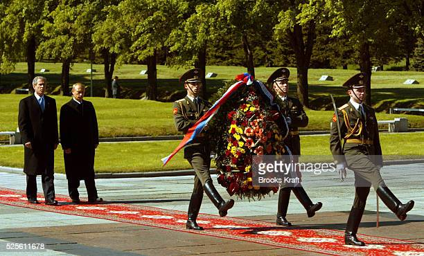 President George W Bush walks with Russian President Valdimir Putin as they prepare to lay a wreath at the Piskarevskoye Cemetery in St Petersburg...