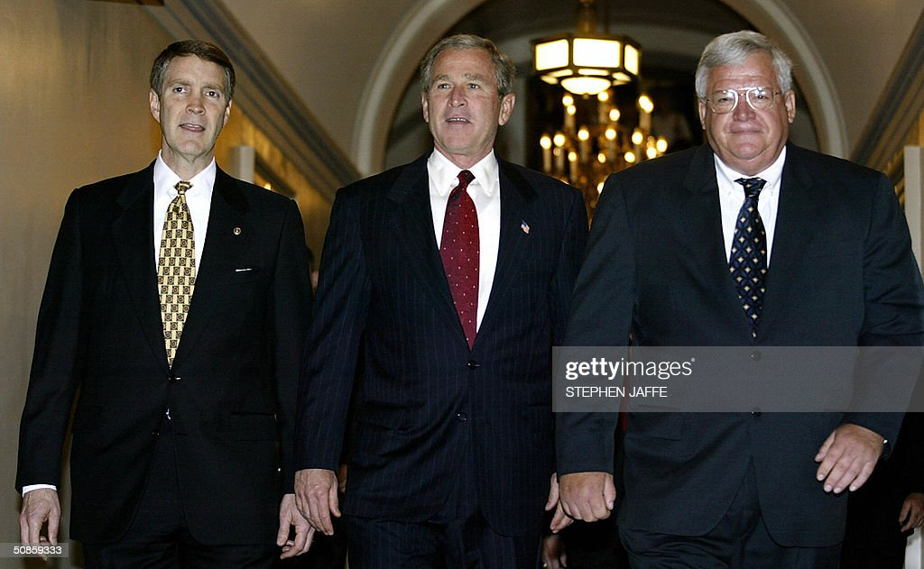 US President George W. Bush (C) walks with Senate Majority Leader Bill Frist (L) and Speaker of the House Dennis Hastert (R) in the US Capitol 20 May 2004 in Washington, DC. Bush is meeting with Republican lawmakers on Capitol Hill. AFP Photo/Stephen JAFFE