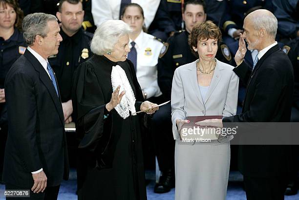 S President George W Bush watches as Homeland Security Secretary Michael Chertoff is sworn in by US Supreme Court Justice Sandra Day O'Connor as his...