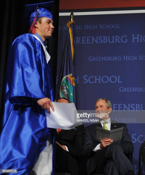 US President George W Bush watches as Senior Class President Jarrett Schaef walks to the lectern to deliver remarks during graduation exercises at...