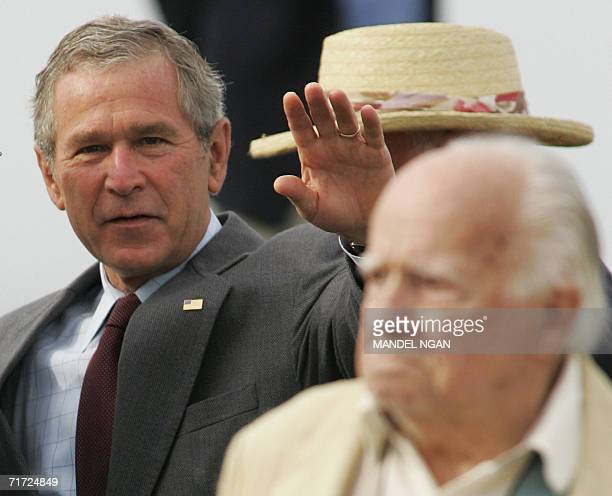 President George W Bush waves after attending Sunday service at Saint Ann's Episcopal Church 27 August 2006 in Kennebunkport Maine Bush was in...