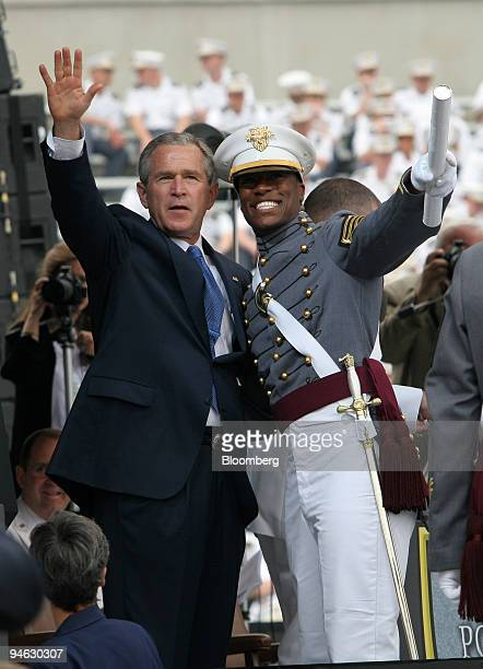 President George W Bush waves after handing a diploma to a cadet following his commencement address to the 2006 graduating class of West Point...