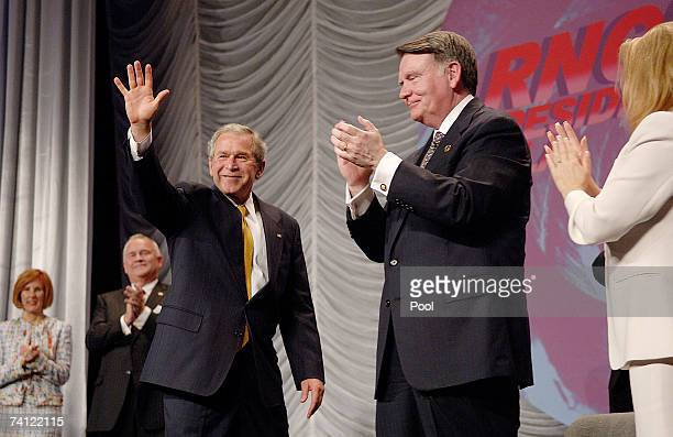 President George W. Bush waves after making remarks as RNC Chairman Robert M. Duncan claps during the Republican National Committee Gala where at the...