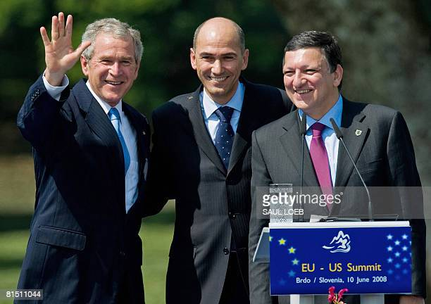 US President George W Bush waves alonside European Union Commission President Jose Manuel Barroso and Slovenian Prime Minister Janez Jansa at the end...