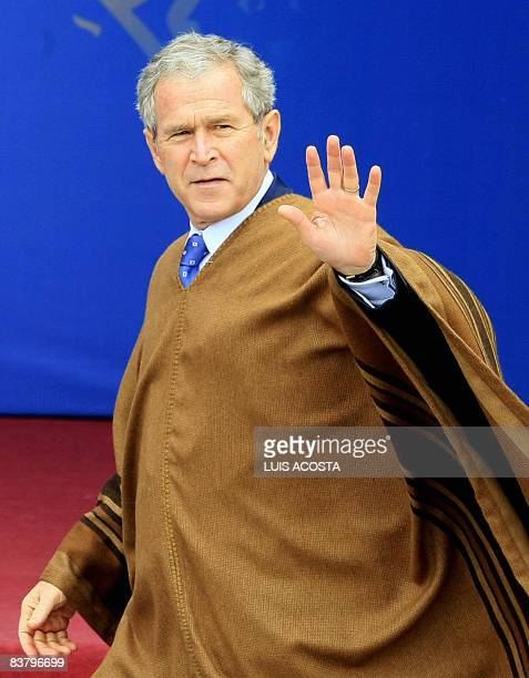 US President George W Bush waves as he arrives for the AsiaPacific Economic Cooperation summit family photo on November 23 2008 in Lima AsiaPacific...