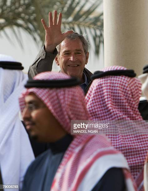 US President George W Bush waves as he boards Saudi King Abdullah bin Abdul Aziz alSaud's SUV after viewing the King's horses 15 January 2008 at the...
