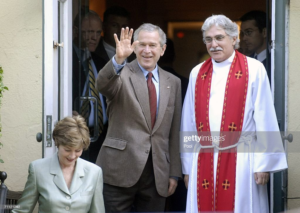 U.S. President George W. Bush (C) waves as he leaves St. John's Episcopal Church with Rev. Luis Leon (R) and first Lady Laura Bush (L) after a Sunday service June 4, 2006 in Washington, DC.