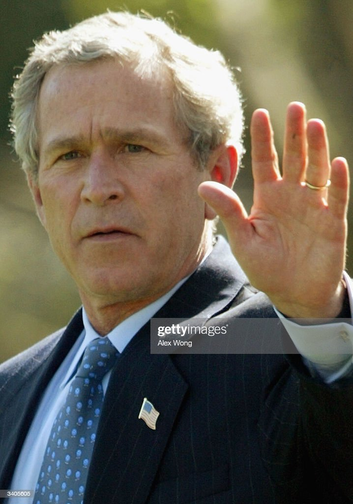 U.S. President George W. Bush waves as he walks towards Marine One April 16, 2004 at the South Lawn of the White House in Washington, DC. Bush will spend his weekend at Camp David.