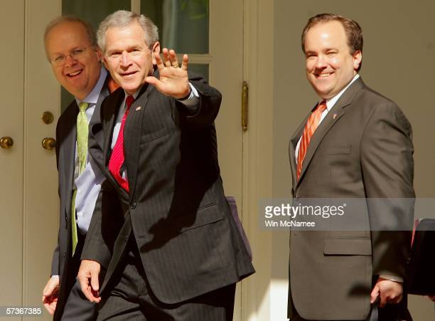 S President George W Bush waves as he walks with his Press Secretary Scott McClellan and Deputy Chief of Staff Karl Rove to the Oval Office at the...