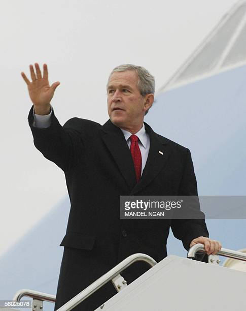 President George W Bush waves before boarding Air Force One 28 October 2005 at Andrews Air Force Base in Maryland Bush is heading for a brief visit...
