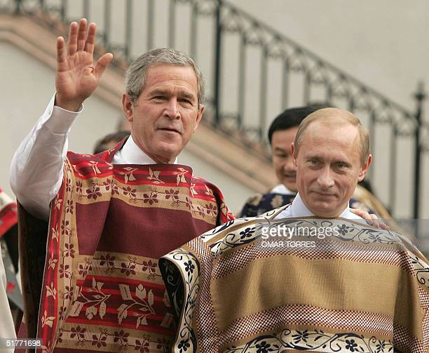 President George W Bush waves next to Russia's Vladimir Putin at the Oranges Patio at La Moneda palace before the official photograph in Santiago 21...