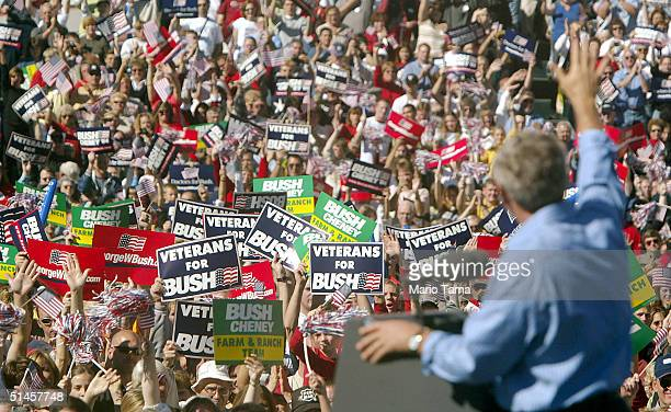 S President George W Bush waves to supporters at a Victory 2004 rally October 9 2004 in Waterloo Iowa Bush met Democratic presidential challenger...
