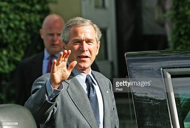 S President George W Bush waves to the news media as he leaves St John's Episcopal Church after a Sunday service May 22 2005 in Washington DC