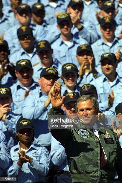 President George W. Bush waves to U.S. Sailors prior to speaking at the Naval Station Mayport February 13, 2003 in Jacksonville, Florida. President...