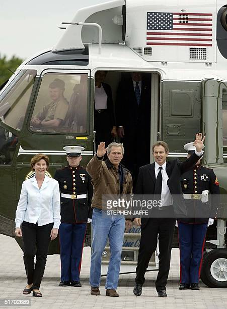 President George W Bush waves with British Prime Minister Tony Blair along with First Lady Laura Bush as Blair arrived at Bush's Prairie Chapel Ranch...