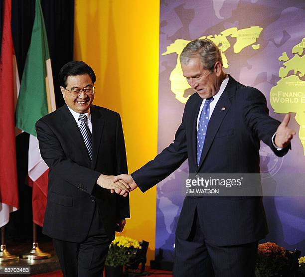 President George W. Bush welcomes Chinese President Hu Jintao to the G20 Summit at the National Building Museum on November 15, 2008 in Washington,...