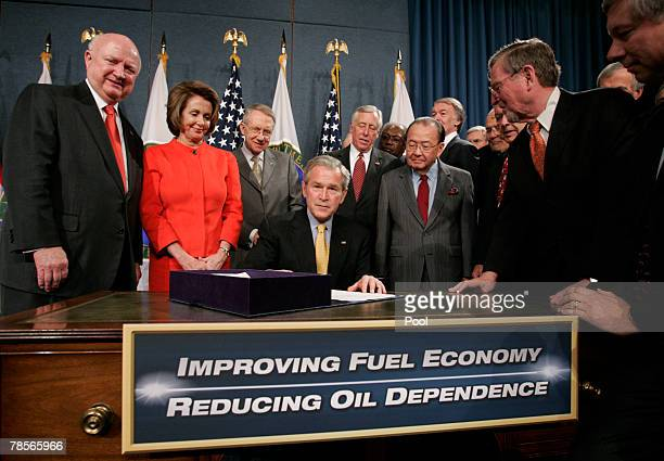 President George W. Bush with Speaker of the House Nancy Pelosi , with U.S. Secretary of Energy Samuel Bodman and other lawmakers, after signing the...