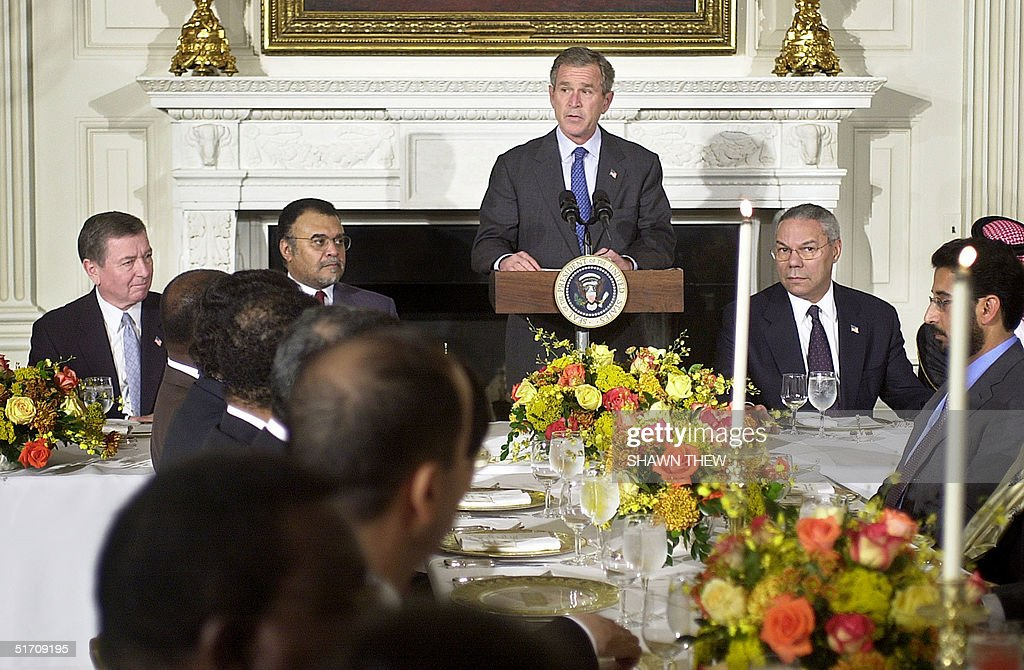 US President George W. Bush, with US Attorney General John Ashcroft (L), Saudi Ambassador Prince Bandar bin Sultan binAbd al-Aziz al-Saud (2nd-L) and US Secretary of State Colin Powell, speaks 19 November 2001 before a prayer by Imam Abdullah Muhammad Khouj during a Ramadan dinner in the East Room of the White House in Washington, DC. Bush hosted some 50 ambassadors from Muslim countries at the White House as Washington steps up its campaign to court Muslim opinion and widen its appeal for humanitarian support and the rights of women in Afghanistan. AFP PHOTO/Shawn THEW