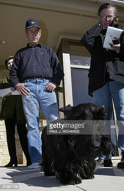 President George W Bush with US First Lady Laura Bush watch as their dog Barney mingles with reporters invited by the President for a tour of their...