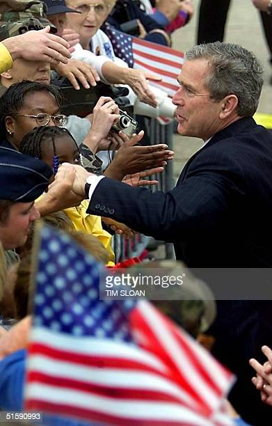 President George W Bush works the rope line after arriving at Tyndall Air Force Base 12 March 2001 in Panama City Florida AFP PHOTO/TIM SLOAN