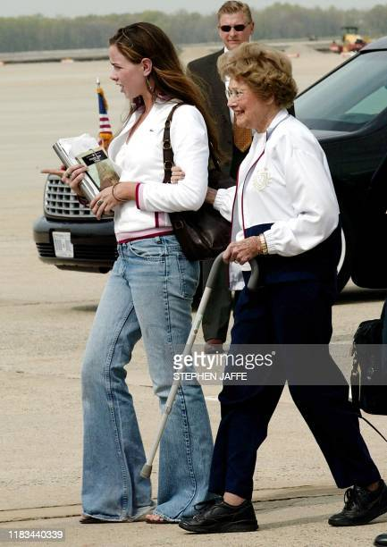 US President George W Bush's daughter Barbara Bush helps her grandmother Jenna Welch into the limosine from Air Force One 21 April 2003 at Andrews...