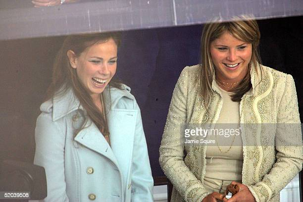 S President George W Bush's daughters Barbara and Jenna wait for their parents to arrive at the inaugural parade reviewing stand in front of the...