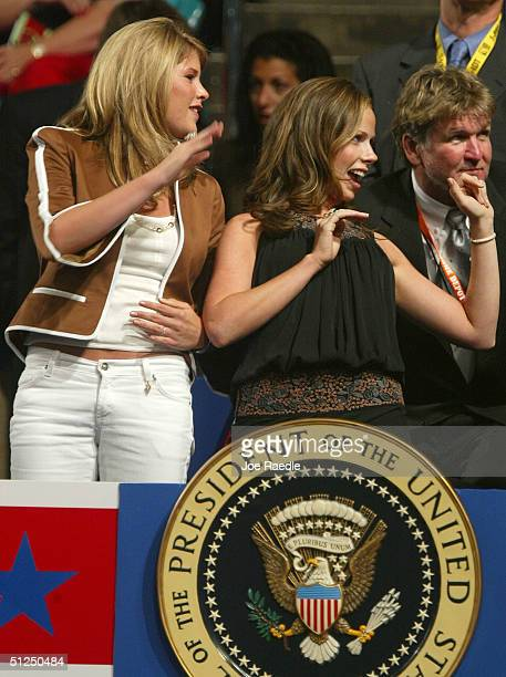 President George W Bush's daughters Jenna and Barbara stand in the presidential box in the audience on night two of the Republican National...