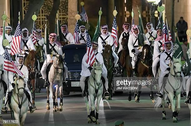 US President George W Bush's motorcade is escorted by Arabian horses as he arrives with Saudi Arabia's King Abdullah bin Abdul Aziz alSaud at the...
