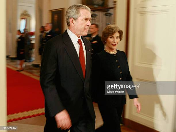 S President George WBush and First Lady Laura Bush arrive at an event in the East Room at the White House November 17 2008 in Washington DC During...
