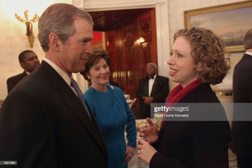 U.S. President George W.Bush talks to Chelsea Clinton at Inaugural festivities at the White House January 20, 2001 in Washington DC.