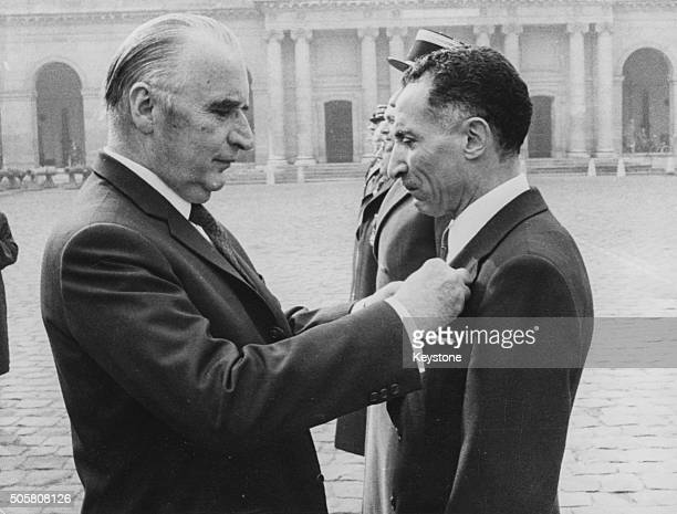 President Georges Pompidou of France decorating Olympic athlete Alain Mimoun with the Legion d'Honneur at a ceremony in Paris 1972