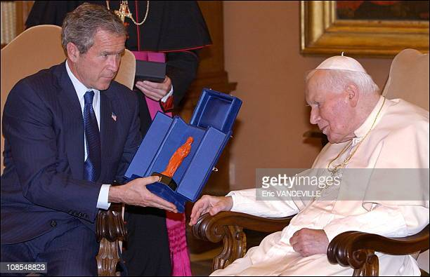 President GeorgeWBush raised with pope JohnPaul II his concern regarding the roman catholic church's standing in light of the sexual abuse scandal...