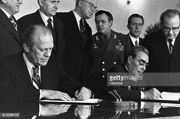 President Gerald Ford and General Secretary Leonid Brezhnev sign a Joint Communique