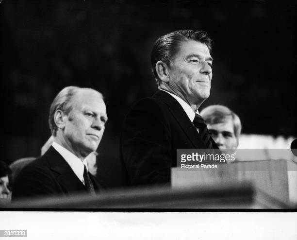 President Gerald Ford listens as American politician Ronald Reagan addresses delegates at the Republican National Convention Kansas City Missouri...