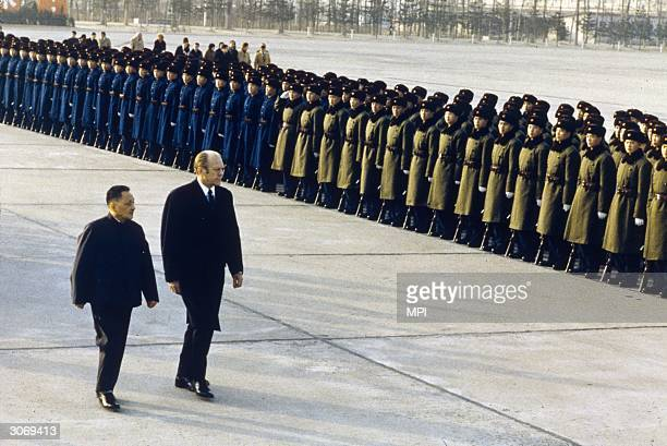 President Gerald Ford reviewing Chinese troops with Chinese Premier Deng Xiaoping