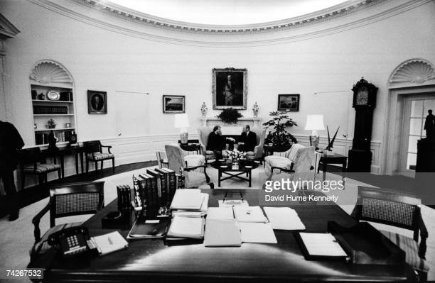 US President Gerald Ford shakes hands with presidentelect Jimmy Carter in the Oval Office congratulating him on his 1976 election victory in the West...