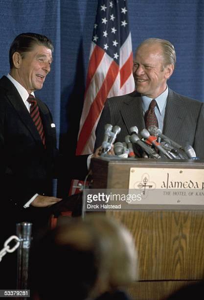 President Gerald Ford standing at podium with Republican presidential contender and ex Governor of CA Ronald Reagan at the GOP National Convention