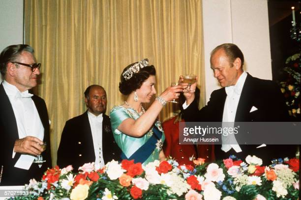 President Gerald Ford toasts Queen Elizabeth II at an American Bicentennial dinner in the Rose Garden during a state visit to the USA by the Queen on...