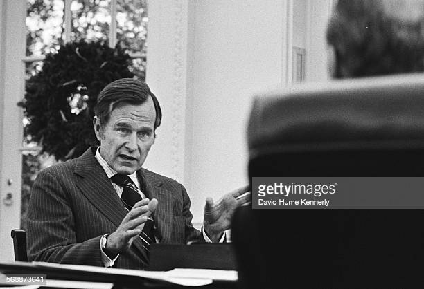 President Gerald R Ford meets with US Representative to the People's Republic of China George Bush in the Oval Office to talk to about Bush taking...