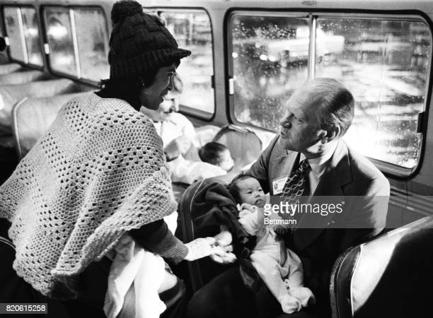 President Gerald R Ford on a bus with one of the first children evacuated from Vietnam during Operation Babylift San Francisco Airport April 5 1975