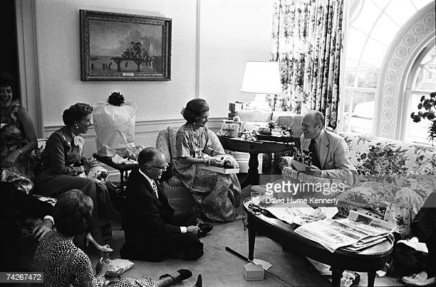 President Gerald R Ford opens gifts at his surprise 62nd birthday party orchestrated by First Lady Betty Ford in the second floor family room of the...