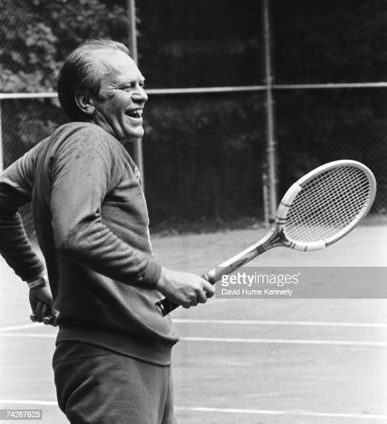 President Gerald R Ford shares a laugh during a rousing tennis match with his son Steven Ford on September 1 1974 during his first visit to Camp...