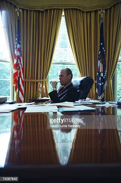 President Gerald R Ford sits at his desk in the Oval Office on August 1974 in Washington DC Ford stepped into office as president on August 9th after...