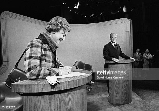 President Gerald R Ford stands at his podium prior to the third presidential election debate as First Lady Betty Ford stands at the other podium...