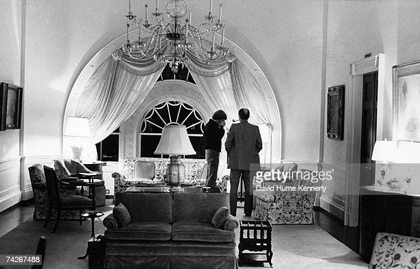 President Gerald R Ford stands with his son John Jack Ford in the second floor family room of the White House Executive Residence on the night of Mrs...