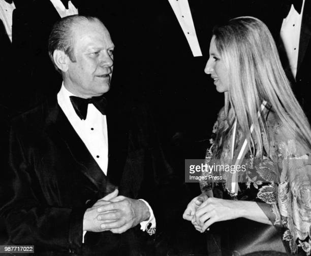 """President Gerald R Ford talks with Barbra Streisand at the Eisenhower Theater for the premiere of """"Funny Lady"""" on March 14th, 1975 in Washington DC."""