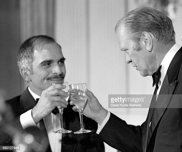 President Gerald R Ford toasts His Majesty King Hussein of Jordan at an official dinner for the king in the State Dining Room at the White House,...