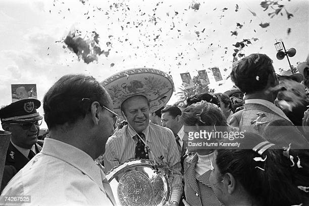 President Gerald R. Ford walks with President Luis Echeverria and the city mayor, Alicia Arellano Tapia de Pavlovich, as he visits La Plaza Del Padre...