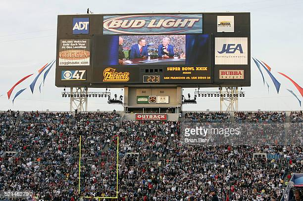 President Geroge H Bush and President Bill Clinton are shown on the jumbotron before the start of Super Bowl XXXIX between the New England Patriots...
